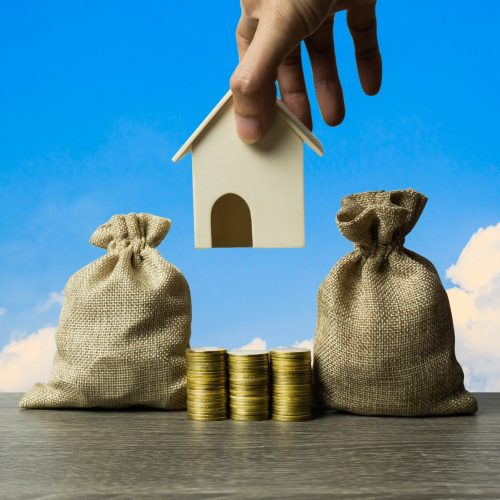Saving money, home loan, mortgage, a property investment for future concept